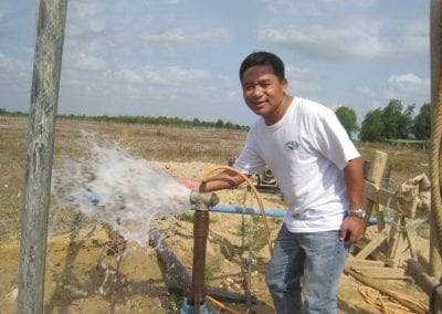 Kot with the new water pump in Myanmar